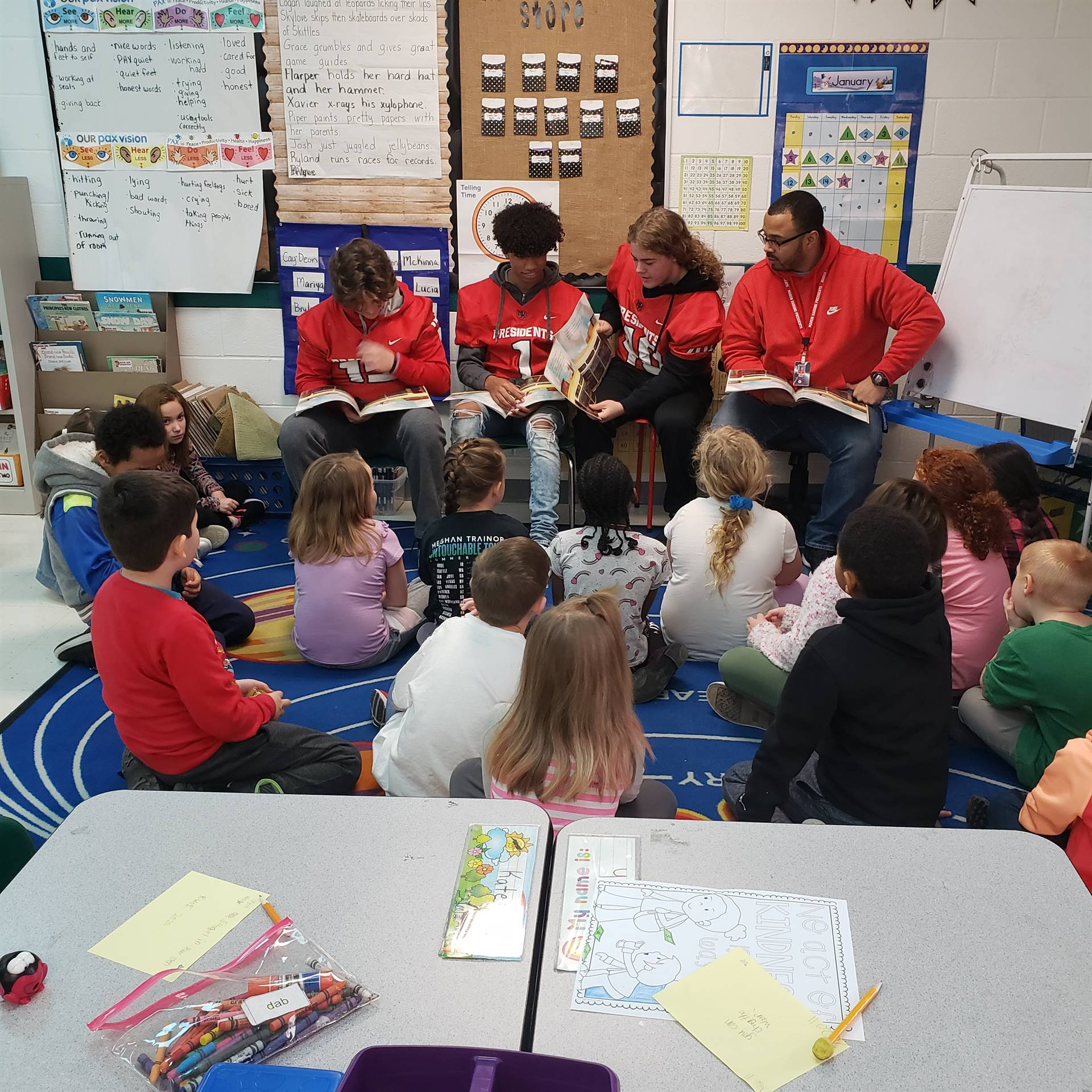 HHS football players reading to elementary students