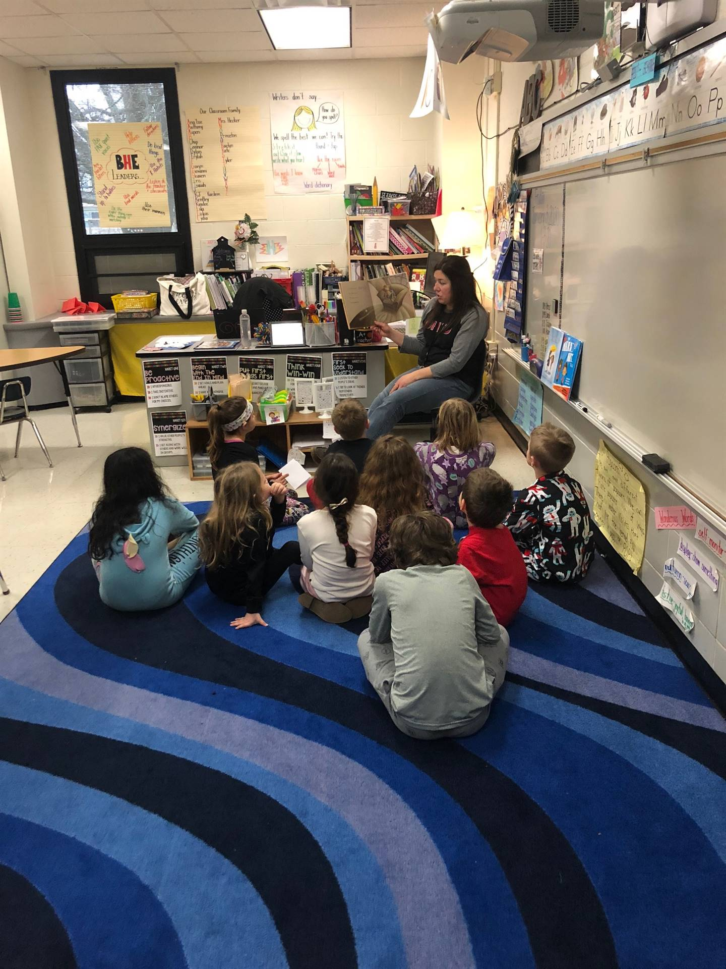 Mrs. Young reading to Harrison students